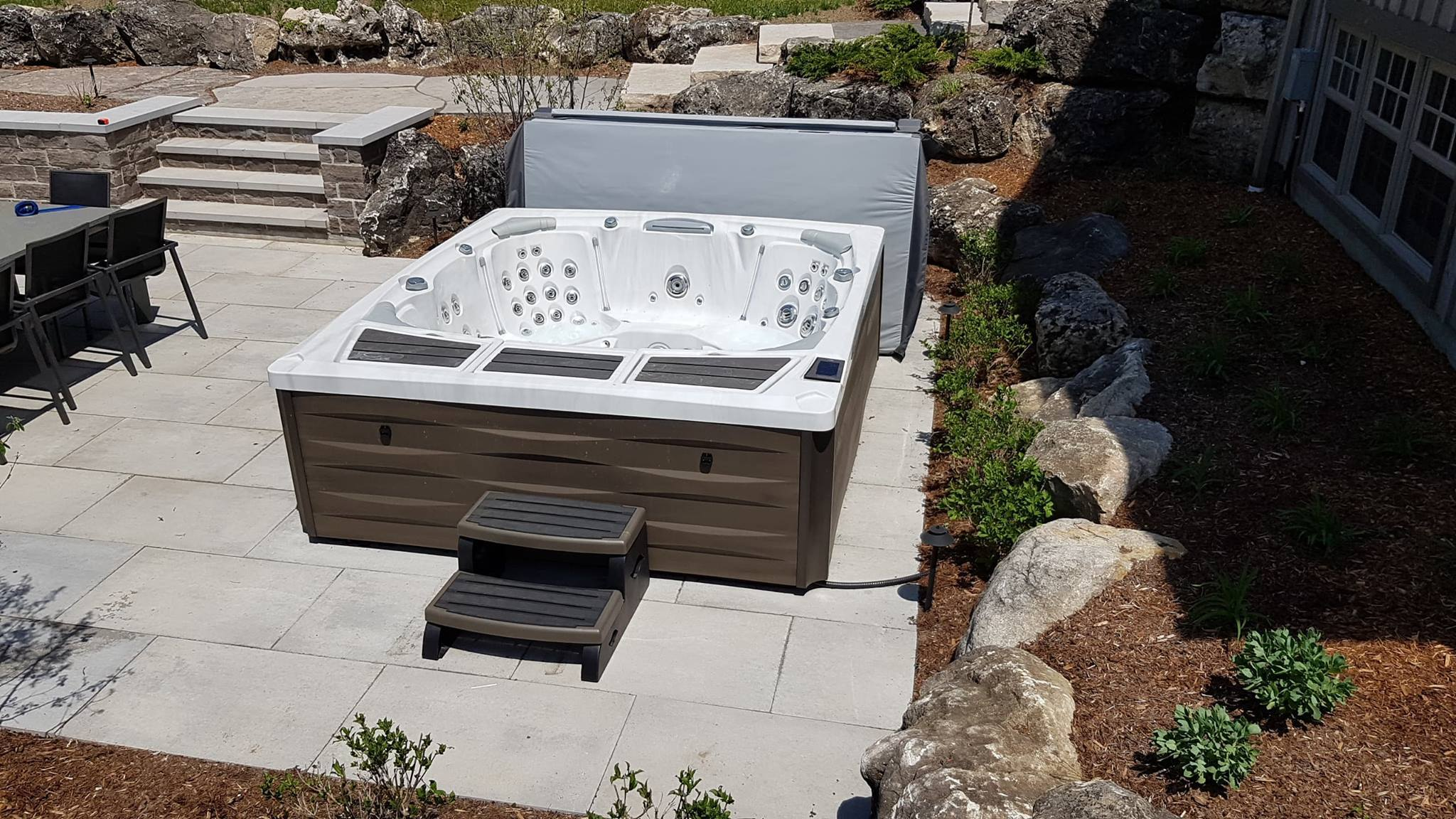 Kingston hot tub installed into a modern backyard.
