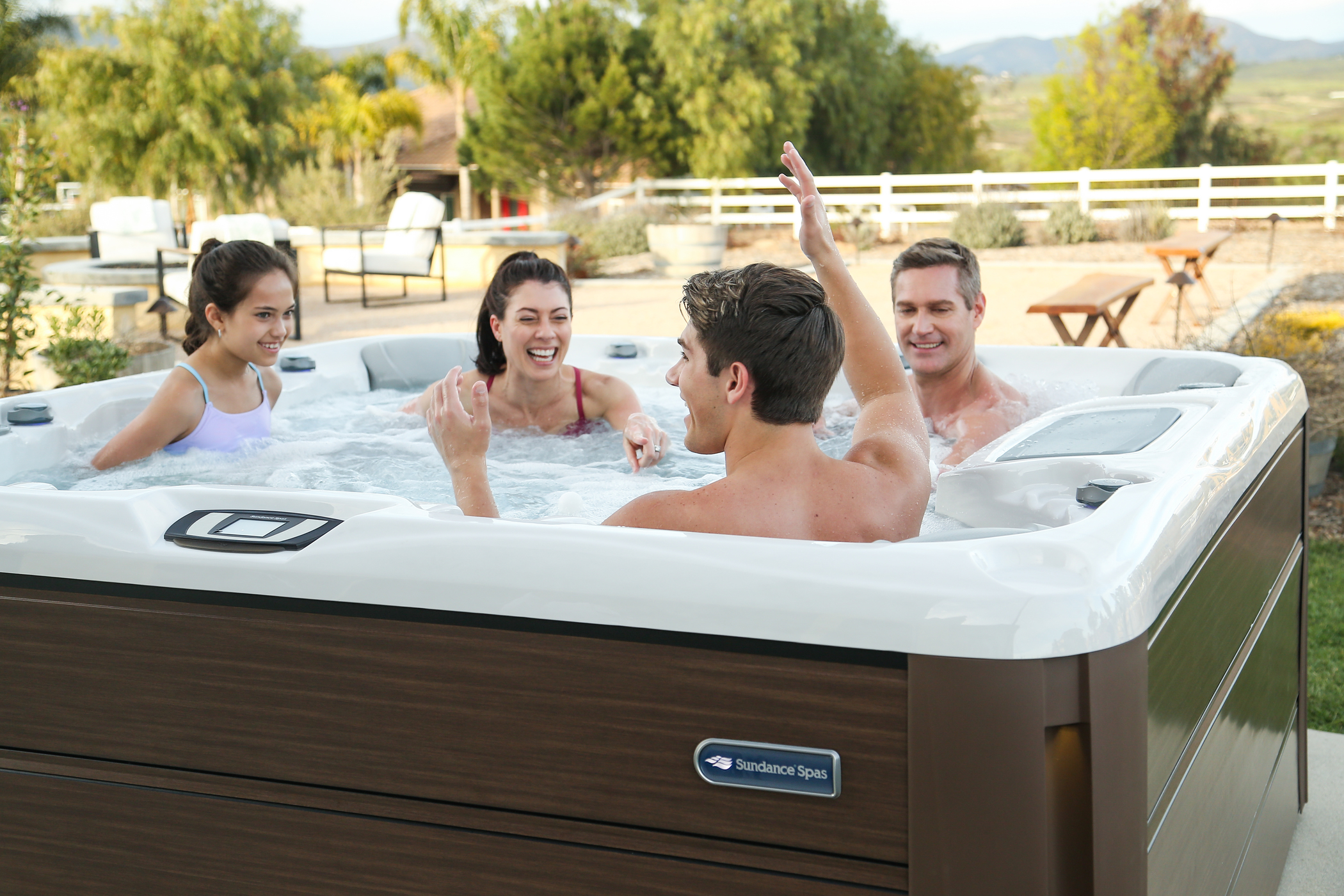 Family enjoying quality time in an outdoor hot tub.